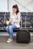 Businesswoman Checking Time At Airport — Stock Photo