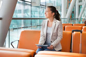 Businesswoman With Digital Tablet At Airport — Stock Photo