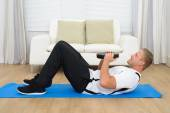 Man Exercising With Plate — Stock Photo