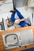 Plumber Examining Kitchen Sink — Stock Photo