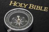 Compass On Holy Bible — Stock Photo