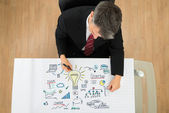 Businessman Drawing Startup Plan — Stockfoto
