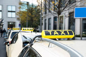 Array Of Taxi Cabs Parked — Stock Photo