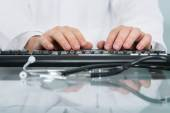 Doctor Typing On Keyboard — Stock Photo