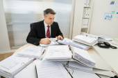 Businessman With Heap Of Folders — Stock Photo
