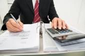 Businessman Calculating Invoice — Zdjęcie stockowe