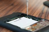 Fixing Cellphone With Screwdriver — Stok fotoğraf