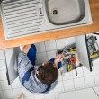 Plumber Repairing Sink — Stock Photo #64645475
