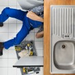 Plumber Repairing Sink — Stock Photo #64645477