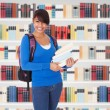 College Student Girl In Library — Stock Photo #64645965
