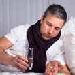 Sick Man Looking At Pills — Stock Photo #64648475
