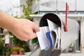Man Taking Letter From Mailbox — Stock Photo