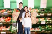 Happy Family In Supermarket — Stock Photo