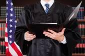 Male Judge Holding Folder — Stock Photo