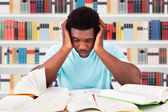 Tired Student In Library — Stockfoto