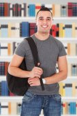 Student With Backpack In Library — Stock Photo