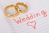 Wedding Rings On Paper — Stock Photo
