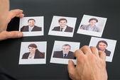 Businessman Holding Photographs — Stock Photo