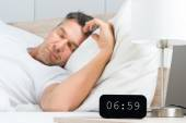 Man With Clock On Nightstand — Stock Photo