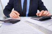 Businessman Calculating Invoices — Stock Photo