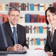 Businesspeople Sitting At Desk — Stock Photo #65209563
