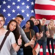 Students In Front Of American Flag — Stock Photo #65209407