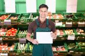 Sales Clerk Holding Placard — Stock Photo