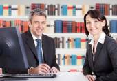 Businesspeople Sitting At Desk — Stock Photo