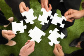 Hands With Jigsaw Puzzles — Stock Photo