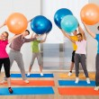 People Lifting Pilates Balls — Stock Photo #65210591