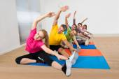 Happy People Stretching Legs — Stock Photo