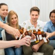 Friends Toasting Beer Bottles — Stock Photo #65674819