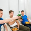 Friends Toasting Beer Bottles — Stock Photo #65675189