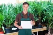 Gardener Holding Placard — Stock Photo