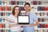 Couple Holding Laptop — Stock Photo