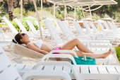 Woman Sunbathing On Lounge Chair — Stock Photo