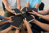People Holding Holy Bible — Stock Photo