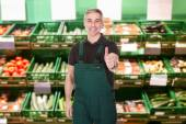Male Sales Clerk Showing Thumb Up — Stock Photo