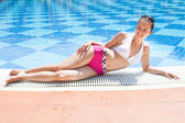 Woman Relaxing At Poolside — Stock Photo