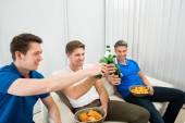 Friends Toasting Beer Bottles — Stock Photo