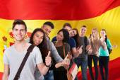 Students In Front Of Spanish Flag — Stock Photo