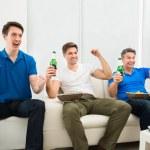 Men Holding Beer Bottles — Stock Photo #67045183