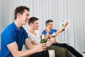 Men Holding Beer Bottles — Stock Photo