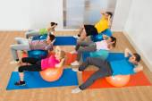 People Exercising On Pilates Balls — Stock Photo
