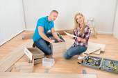 Couple Assembling Furniture — Stok fotoğraf