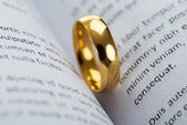 Golden Ring on book — Stock Photo