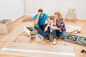 Couple With Disassembled Furniture — Stock Photo