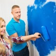 Young Couple Painting Wall — Stock Photo #70475141