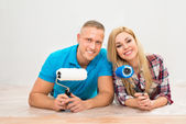 Happy Couple With Paint Rollers — Stock Photo