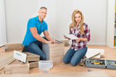 Couple Assembling Furniture — Stock Photo